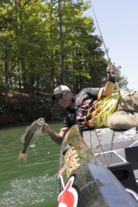 Jeff Kriet with a Bass Caught on a Big Worm - photo by Dan O'Sullivan