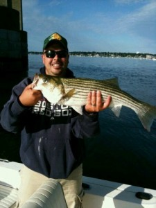 The Author with a Nice Striper Caught from a Bridge Piling