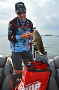 Brent Chapman loads his bag at Lake Cayuga
