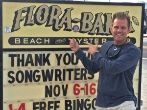 Alan McGuckin in front of the Flora-Bama sign