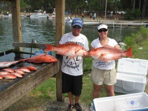 Dustin and wife Marylynn show off their catch from deep sea fishing