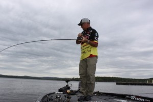 Jeff Kriet Battles a Bass Hooked on Big Worm - photo by Dan O'Sullivan