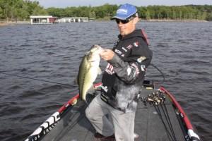 John Crews Examines his Catch - photo by Dan O'Sullivan