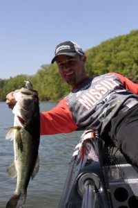 John Crews with a Four Pound Largemouth caught on the Baby Fat John 50 - photo by Dan O'Sullivan