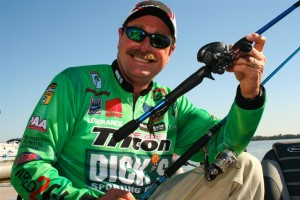 Shaw Grigsby with winning rods and reels