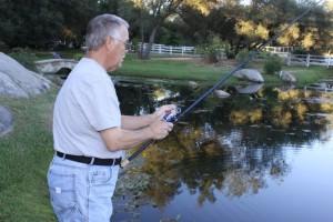 The Author's Father Mark O'Sullivan fishing a Pond - photo by Christina O'Sullivan