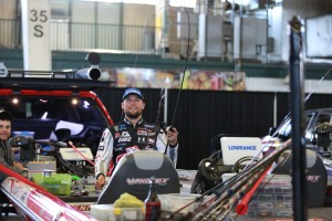 Justin Lucas looks for the perfect rod action and has his boat deck covered in tackle.